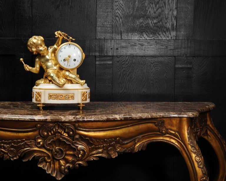 Ormolu and White Marble Antique Clock, Putto Floating in Clouds Playing a Drum In Good Condition For Sale In Belper, Derbyshire