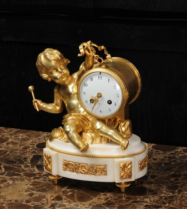19th Century Ormolu and White Marble Antique Clock, Putto Floating in Clouds Playing a Drum For Sale