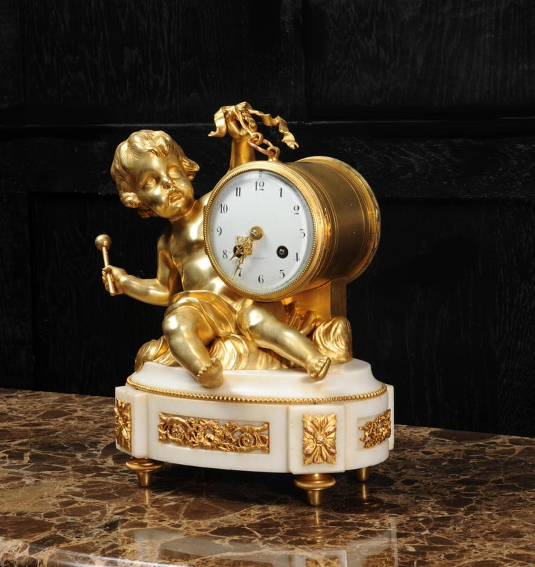 Ormolu and White Marble Antique Clock, Putto Floating in Clouds Playing a Drum For Sale 1