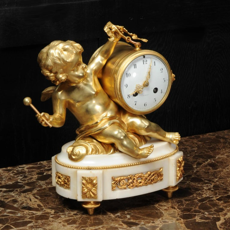 Ormolu and White Marble Antique Clock, Putto Floating in Clouds Playing a Drum For Sale 2