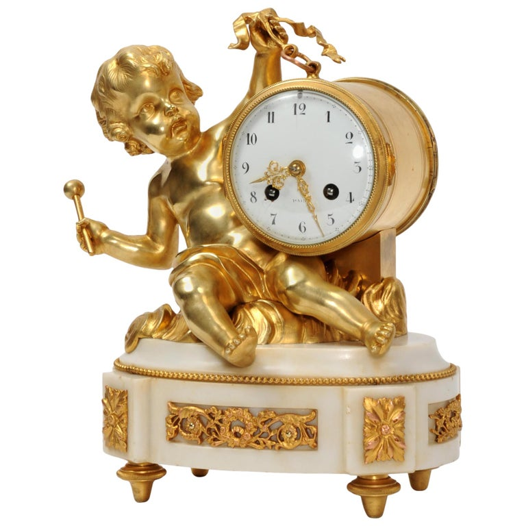 Ormolu and White Marble Antique Clock, Putto Floating in Clouds Playing a Drum For Sale