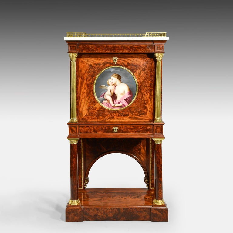 An ormolu-mounted mahogany secrétaire In the manner of S. Jamar  The central panel inset with A rare hand painted porcelain plaque On Vienna porcelain After the original by Franceschini  Constructed from the finest flamed Cuban mahogany and