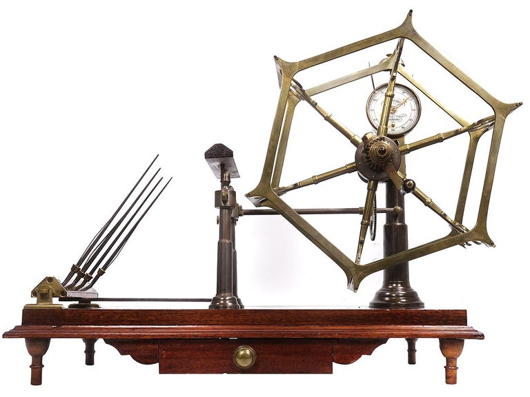 This is an elaborate and early Victorian Wool Winder. It sits on a wood platform with a single draw and turned legs. Its English made and signed... John Nesbitt Maker. The whole mechanism is solid brass with hand filed decorative details. Elaborate