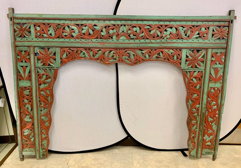 Magnificent vintage carved king headboard  from Bali, circa late 19th century that was acquired by our client via a Paris Flea market purchase back in the 1970s. The colors, green and red are quite vibrant but the intricate carved detail makes it a
