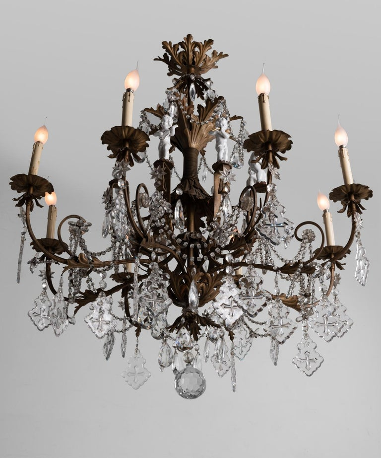 Italian Ornate Brass Chandelier with Porcelain Figures, Italy, circa 1920 For Sale
