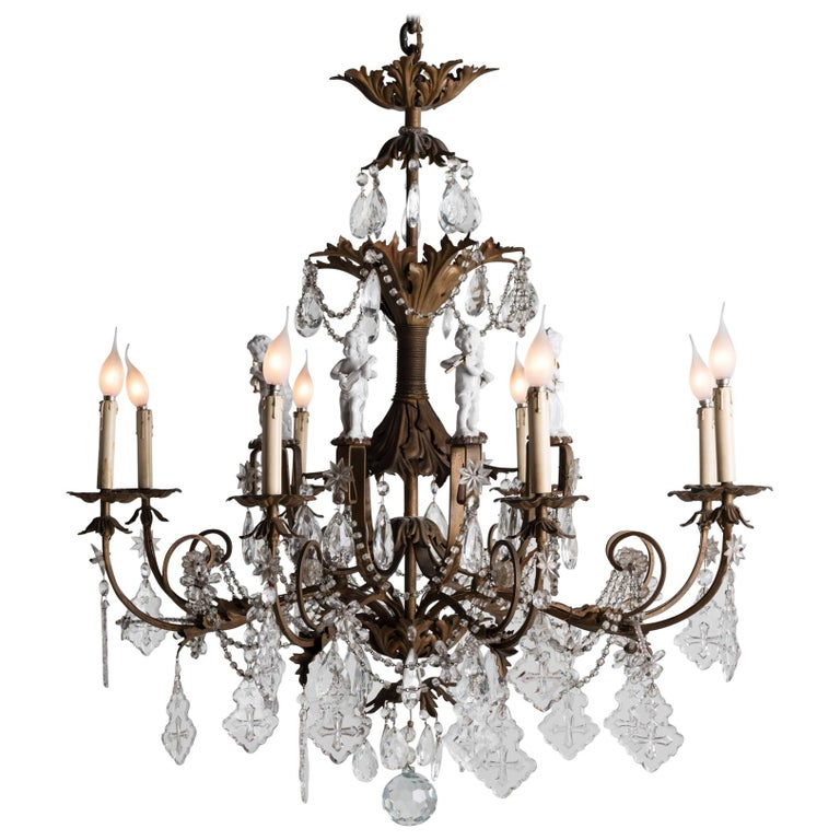 Ornate Brass Chandelier with Porcelain Figures, Italy, circa 1920 For Sale