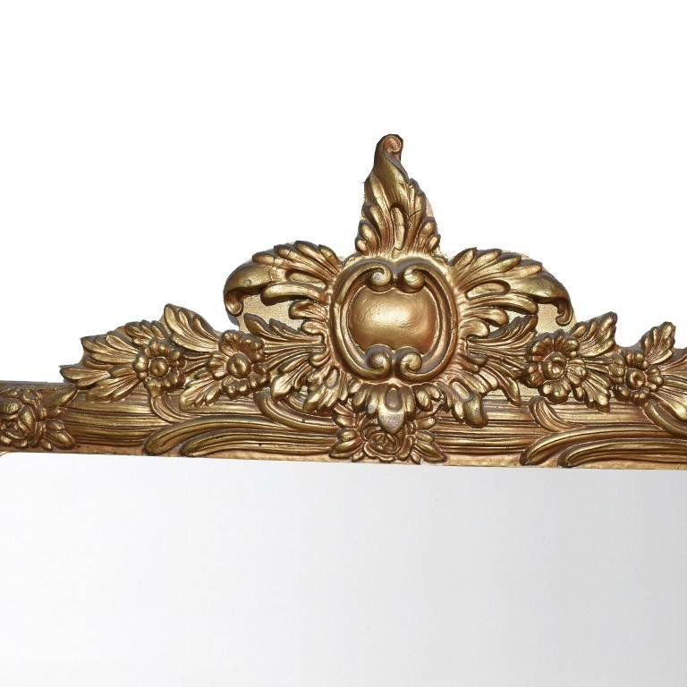 Large rectangular giltwood mirror. In a wide rectangular shape, with hand-carved details on top. Wear is consistent with age. Gorgeous over a mantel, or as an addition to a wall of mirrors. Back includes a wire for hanging.