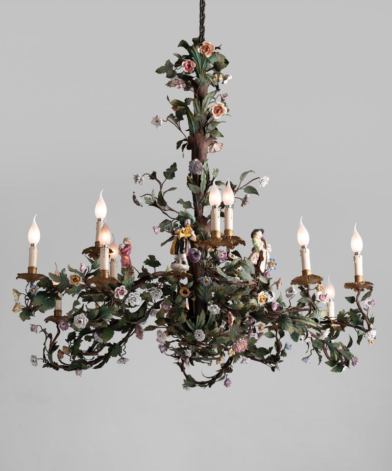 Iron Floral Chandelier with Porcelain Figures, Italy circa 1920  Exquisite hand-painted iron leaves with porcelain floral elements and hand-painted porcelain musical figurines.