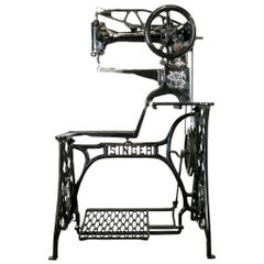 Ornate Singer Cobbler Sewing Machine on a Treadle Stand