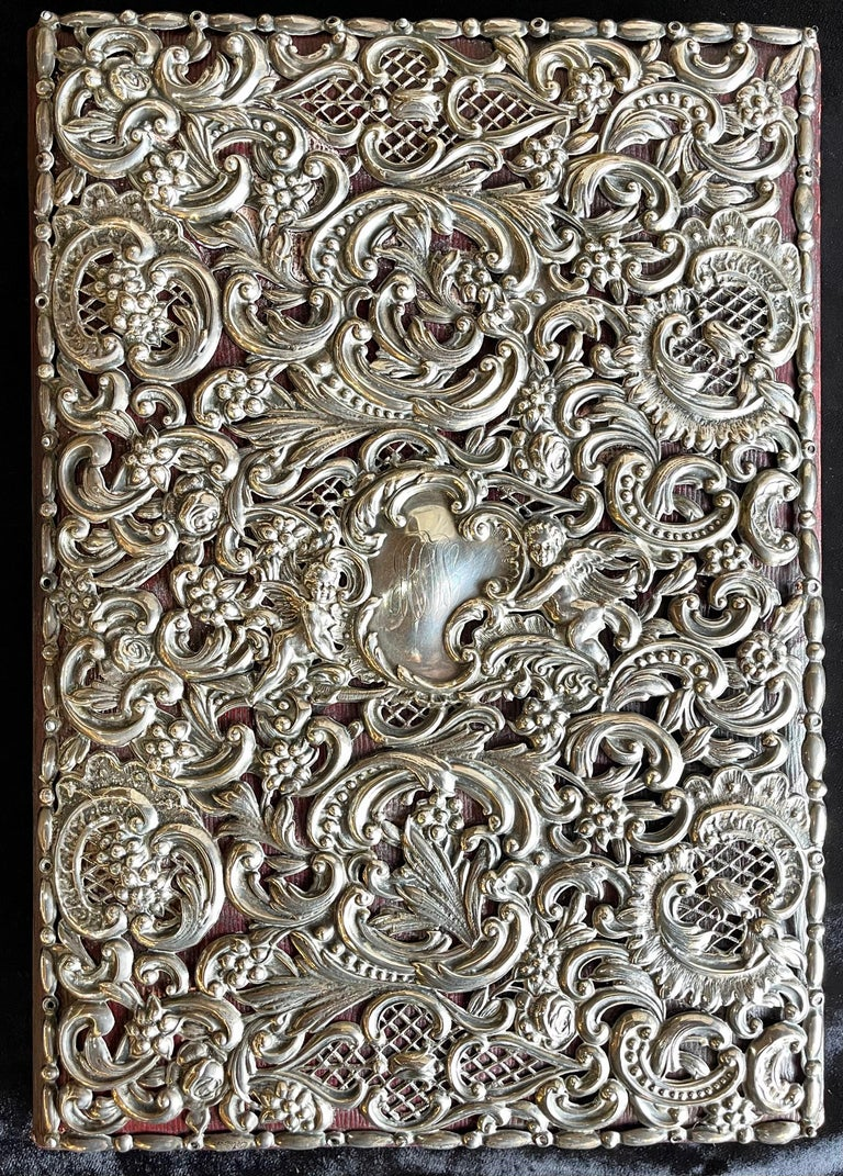 Ornatesterling silver book cover photo scrap album w red leather interior. Large and impressive.  Marked Sterling 48   Meryl.