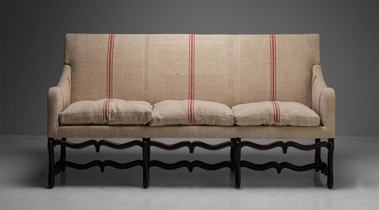 """Os de Mouton Sofa, France, circa 1790  Beautifully carved frame with unique double stretcher. Seats and back have been newly upholstered in antique linen.  Measures: 79"""" W x 30"""" D x 42"""" H x 18.5"""" seat."""