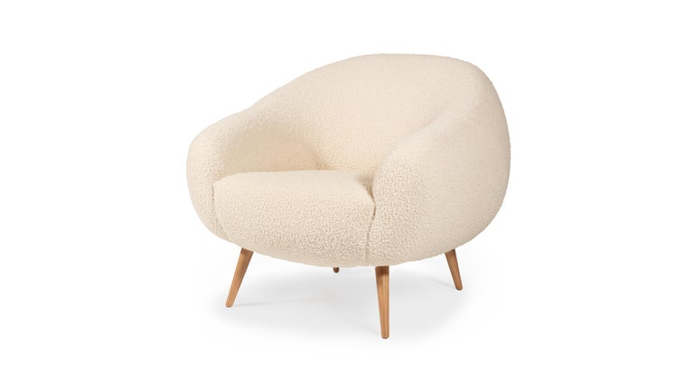 The rounded lines of this early 1950s style armchair are influenced by the