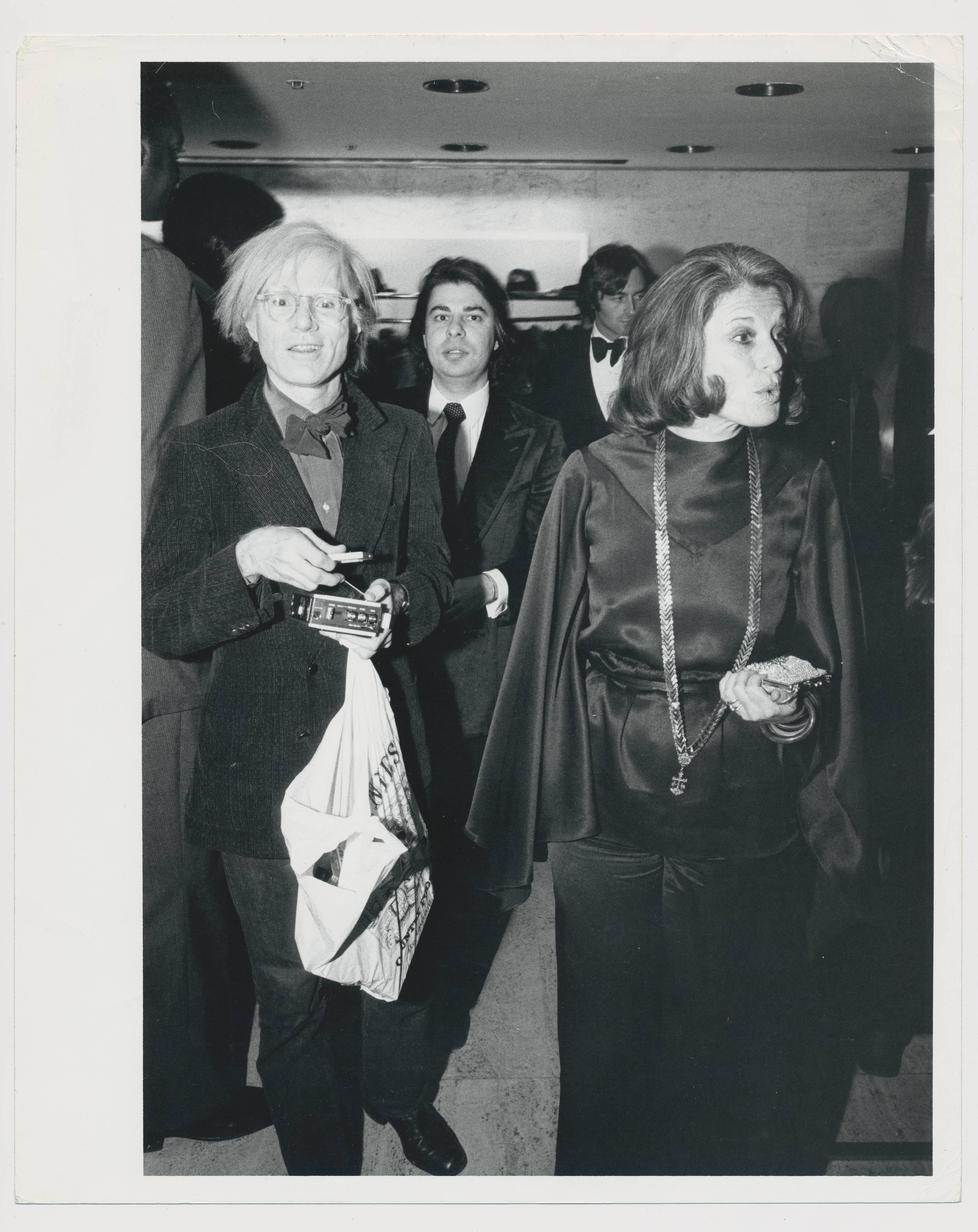 Andy Warhol with shopping bag