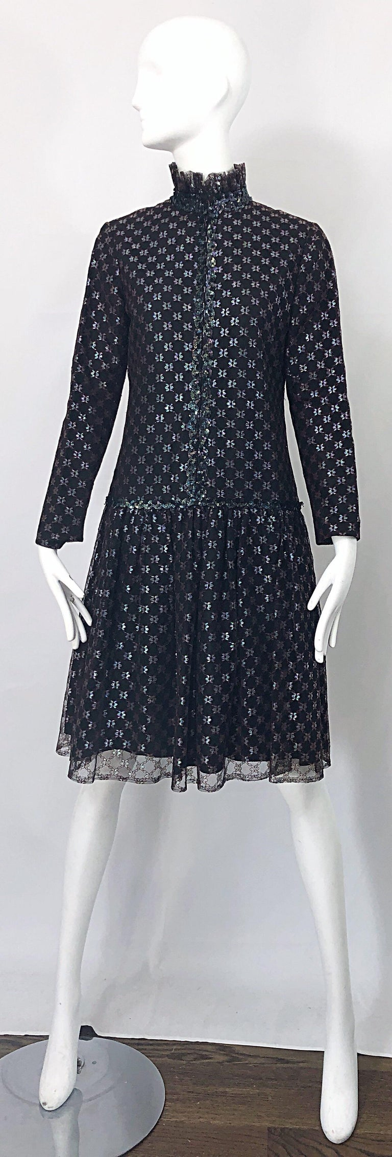 Chic 70s vintage OSCAR DE LA RENTA black and burgundy red long sleeve drop waist dress! Features a Victorian / Renaissance vibe that was very distinct in the early 1970s. Features black taffeta, with a black and burgundy tulle overlay. Hundreds of