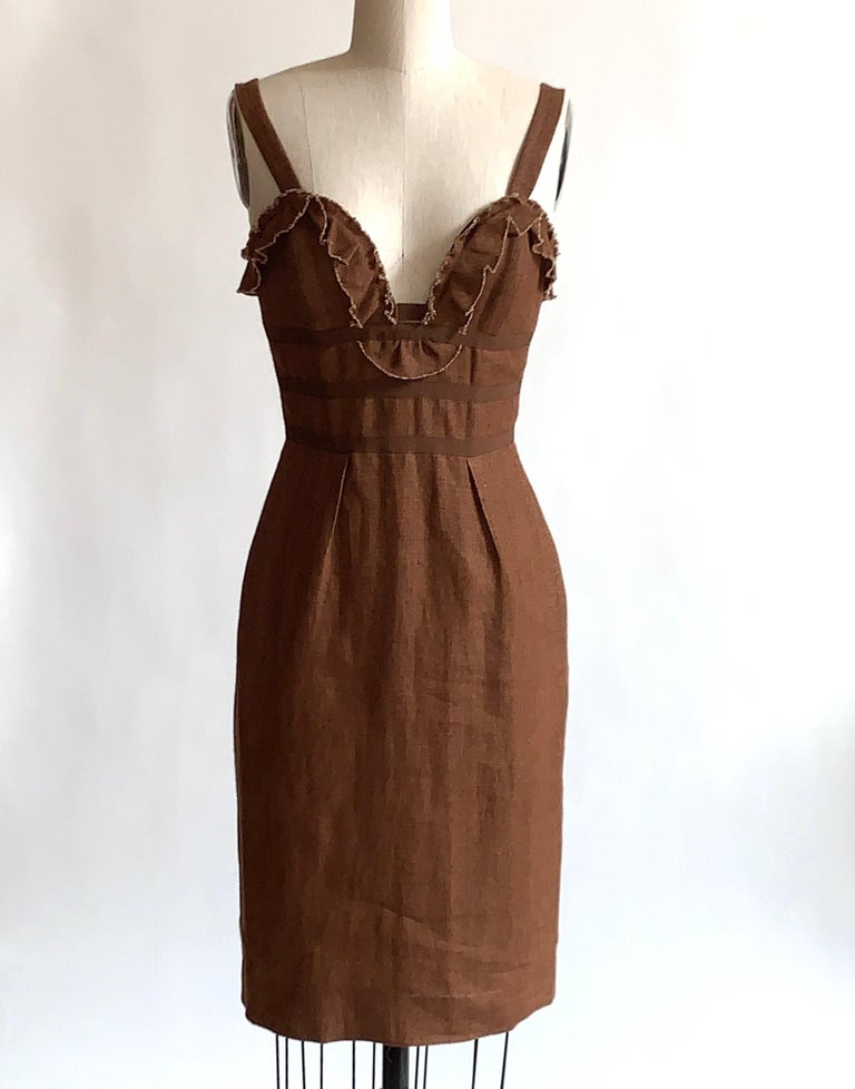 Oscar de la Renta brown pencil dress with raw edged ruffle trim. Grosgrain trim circles the bodice. Boned at bodice for shape.  Back zip and hook and eye.  Seen in another color in Look 2 of de la Renta's Resort 2007 show.  97% cotton, 3% lycra.