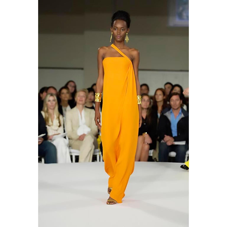 Stunning tangerine orange evening gown by Oscar de la Renta from his 2008 Cruise line. This dress has a fitted