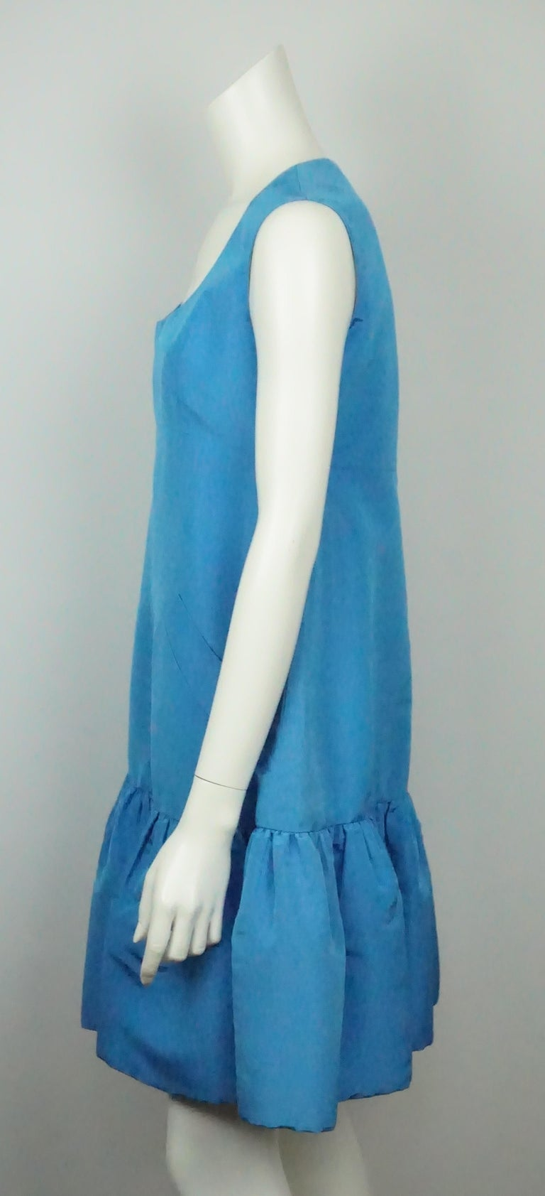 Oscar De La Renta Blue W/ Ruffle Bottom Dress - 8. This beautiful Oscar De La Renta sleeveless dress is in great condition. It has minimal signs of use. The dress is a vibrant blue color and made of taffeta. It is a shift dress type fit, very loose
