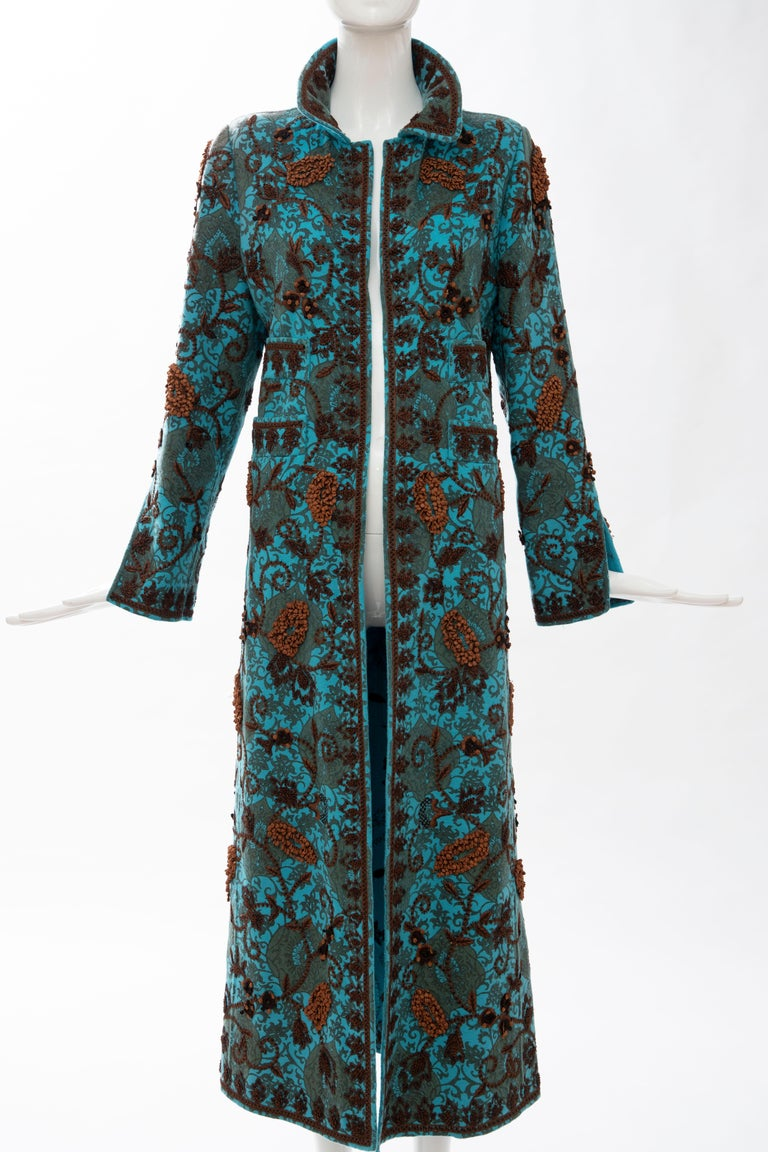 Oscar De La Renta cerulean cashmerecoat featuring floral chocolate brown and rust bead embroidery throughout with structured shoulders, pointed collar, dual patch pockets and open front.  US. 8 Bust: 36,  Waist: 36, Hip: 44, Shoulder: 15, Length: