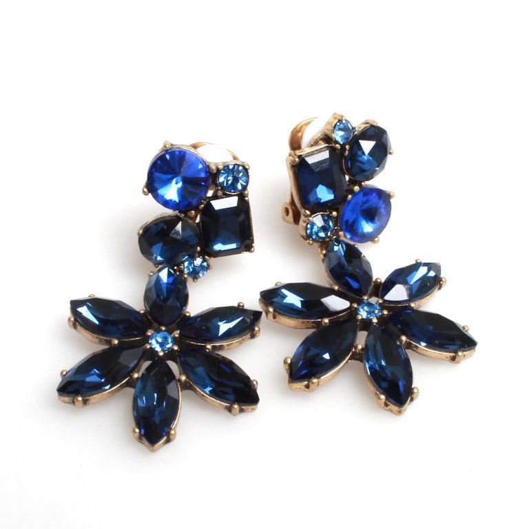 Oscar de la Renta blue floral drop clip on earrings with silver toned metal.