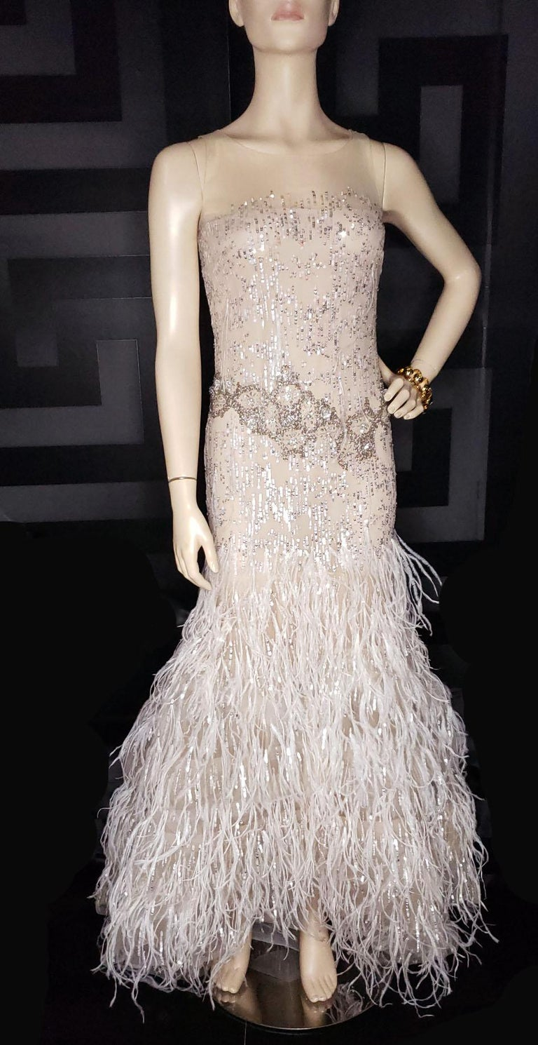 OSCAR DE LA RENTA   Embellished nude tulle evening gown.  Sequins, crystals, feathers.  Extremely rare and highly collectible.  Size 6  Excellent condition