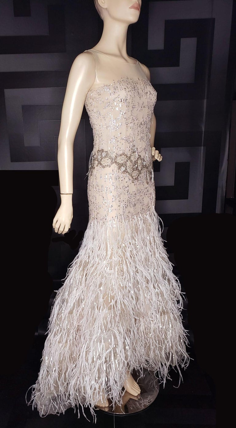 OSCAR DE LA RENTA FEATHER and SEQUIN EMBELLISHED NUDE TULLE GOWN In Excellent Condition For Sale In Montgomery, TX
