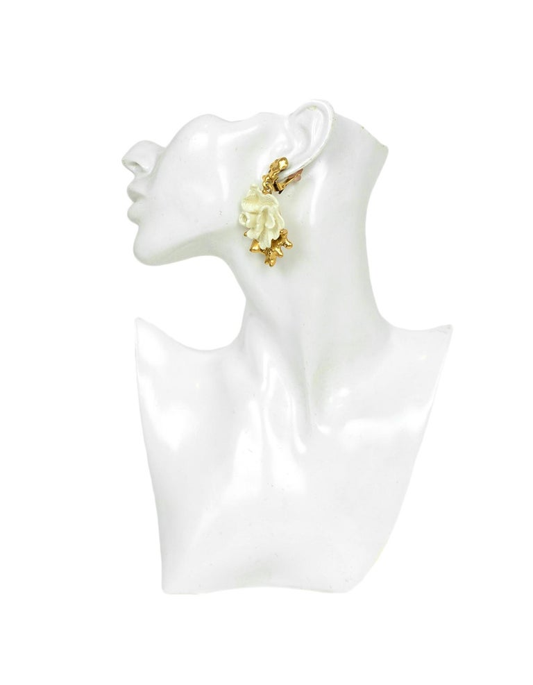 Oscar de la Renta Flower Clip on Earrings   Made In: USA Color: White, Gold Materials: Metal Hallmarks: