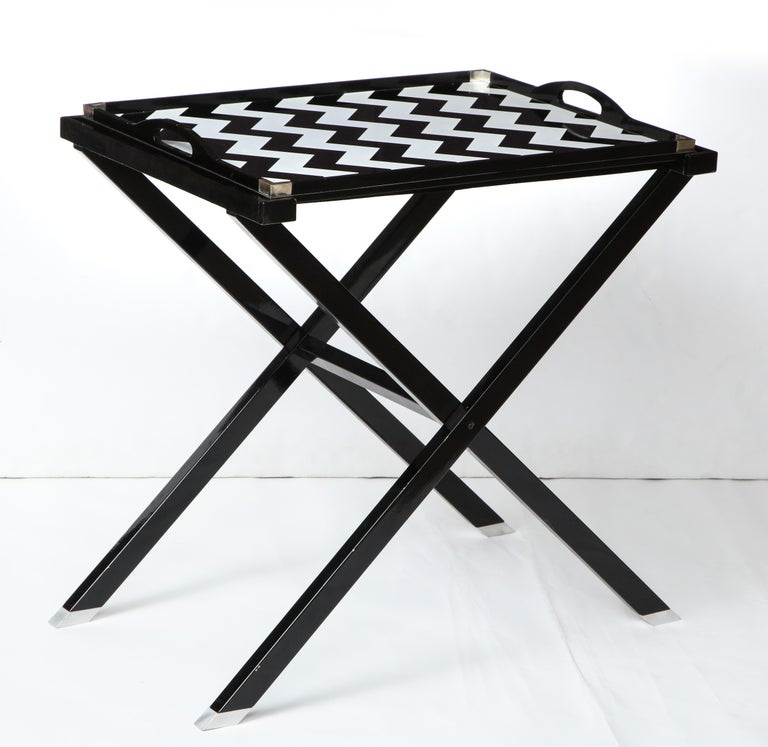 A beautiful and practical folding tray table for the company Lunt designed by Oscar De la Renta.