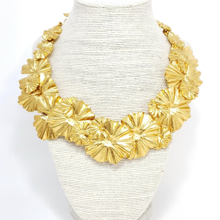 A bold statement necklace from Oscar de la Renta, featuring a strand of clustered golden leaves which rest on the collar.  Hallmarks: Oscar de la Renta, Made in USA  Length: 13 to 16.5 inches