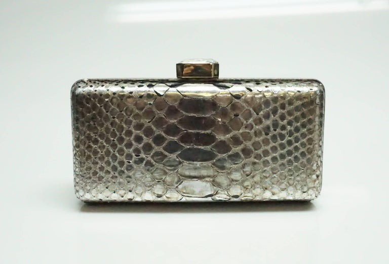 Oscar De La Renta Metallic Python Box Clutch  This beautiful piece is in good condition with some of the python skin a bit lifted. The entire outside of the clutch is made up of python skin and a leather trim. The inside is lined with silk. The
