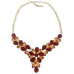 Oscar De La Renta Necklace in gilt with ruby rhinestones