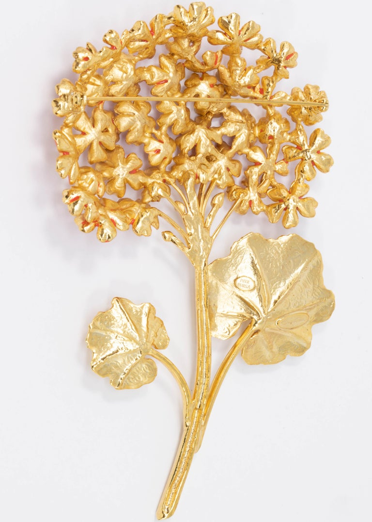 A magnificent bouquet of flowers! This Oscar de la Renta pin brooch features geranium flowers on a golden stem.  22KT gold plated. Hand-painted cayenne orange enamel.  Tags, Marks, Hallmarks: Oscar de la Renta, Made in USA