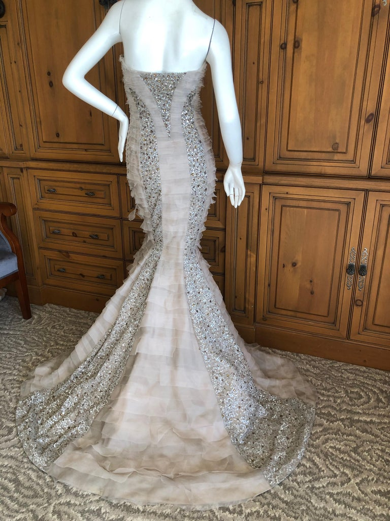 Oscar de la Renta Raw Edge Embellished Layered Mermaid Dress with Inner Boned Corset Simply Stunning. Please use the zoom feature to see all the remarkable details. This is very tight in the thigh and knee area, a true mermaid dress. Size 2, there