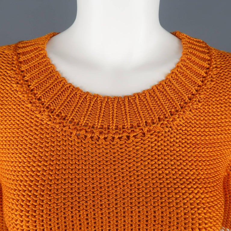 OSCAR DE LA RENTA pullover sweater comes in an orange silk knit with cream stripes with a round crewneck and three quarter sleeves. Made in France.  Retail: $1500 Excellent Pre-Owned Condition. Marked: M   Measurements:   Shoulder: 13 in. Bust: 36