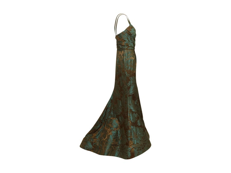 Product details: Teal and brown jacquard bustier gown by Oscar de la Renta. From the Fall 2011 Collection. Surplice neckline. Boning at interior bodice. Brocade pattern throughout. Zip closure at back. 31