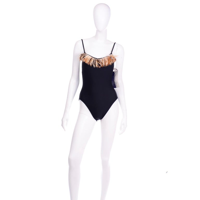 We adore this deadstock Oscar de la Renta black one piece swimsuit with brown feathers along the bust. We think you could wear this as a bodysuit style top with a skirt or pair of pants! This swimsuit has the original Oscar de la Renta tags along