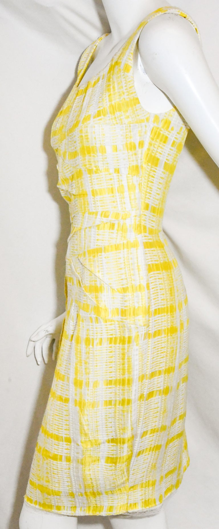 Oscar de la Renta yellow and white check textured fabric includes a scoop neckline and is slightly This dress is elegant yet contemporary.  Dress is lined and is gathered at the neckline and, for closure, includes a long zipper at back with a vent