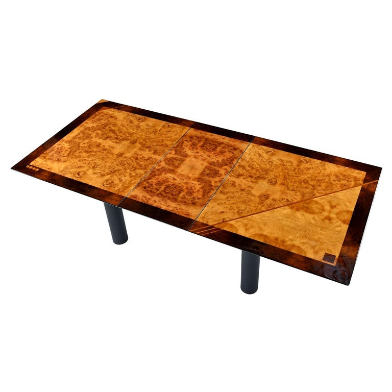 Design aficionados will spot the Italian modern pedigree of this dining table from a mile away. Everyone else will just recognize that it's dripping with cool. This burl bird's-eye maple and rosewood beauty was designed by Oscar Dell'Arredamento for