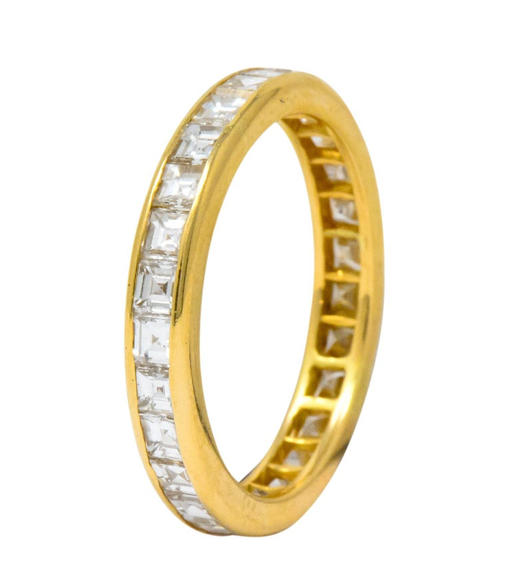 Channel set all the way around with square step cut diamonds weighing approximately 1.35 carats total, H/I color and VVS clarity  With polished gold profile  Maker's mark for Oscar Heyman, numbered, and stamped 18k for 18 karat gold  Ring Size: 6 &