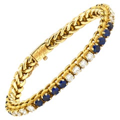 Oscar Heyman 18 Karat Gold Tennis Bracelet with Diamonds and Blue Sapphires