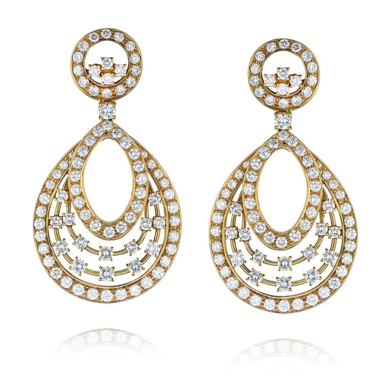 13 Carat Round Cut Diamond Dangling Earrings.   Talk about a wow factor! These magnificent snowflake-style diamond dangling earrings by Oscar Heyman are certainly a show stopper!  Mounted in 18k yellow gold with 13 carats of diamonds these earrings