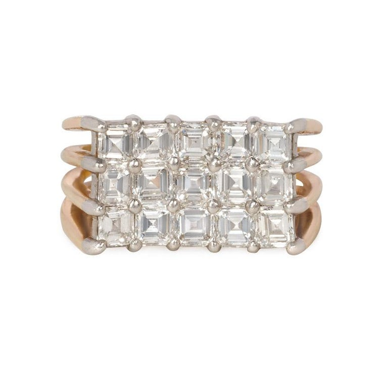 A pavé square emerald cut diamond plaque ring of angled concave design with split shoulders, in 18k gold and platinum.  Oscar Heyman Bros., #95375.  Atw 3.50 ct. diamonds.  Horizontal measurement of top of ring: 5/8