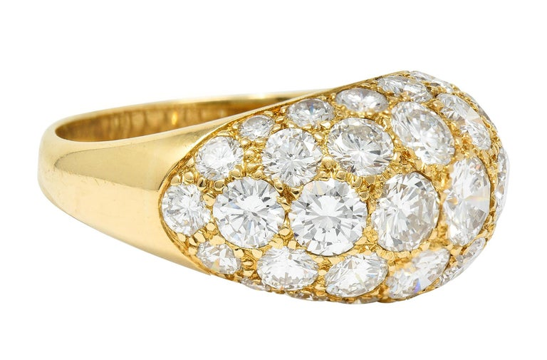 Domed bombè style band is pavè set to front with round brilliant cut diamonds  Graduating in size while weighing in total approximately 7.50 carats - G to I color with VS clarity  Stamped 18K for 18 karat gold  Numbered with maker's mark for Oscar