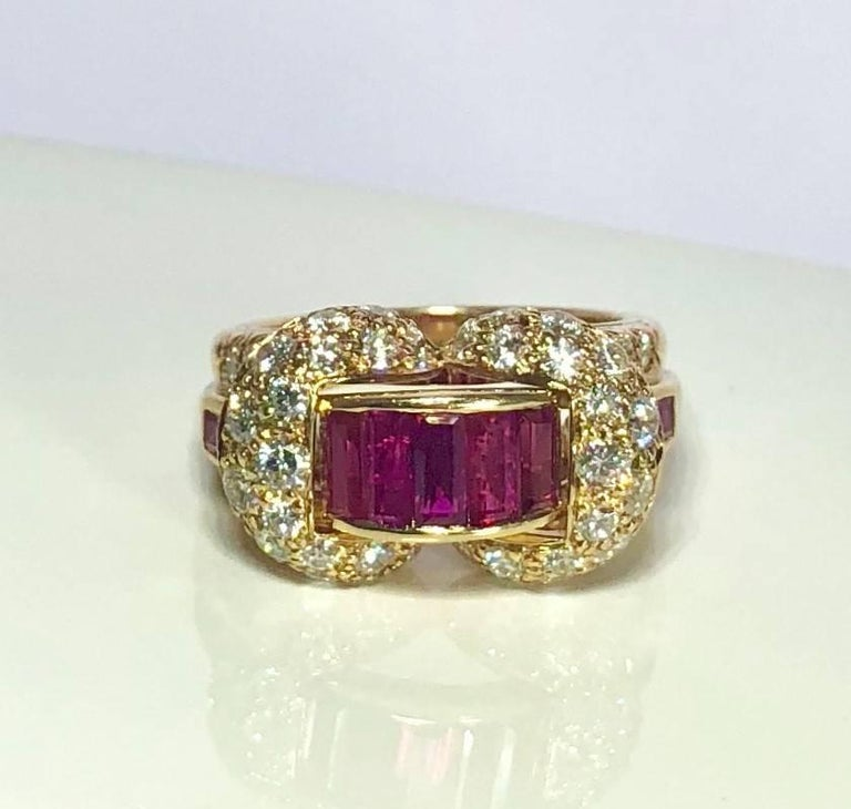Oscar Heyman and Brothers  18 karat yellow gold, Ruby and Diamond cocktail ring. This Exquisite piece is created in 16.3 dwt (9.8 grams) of  18 karat yellow gold and is adorned with 2.76 carat total weight Ruby baguettes strategically placed in