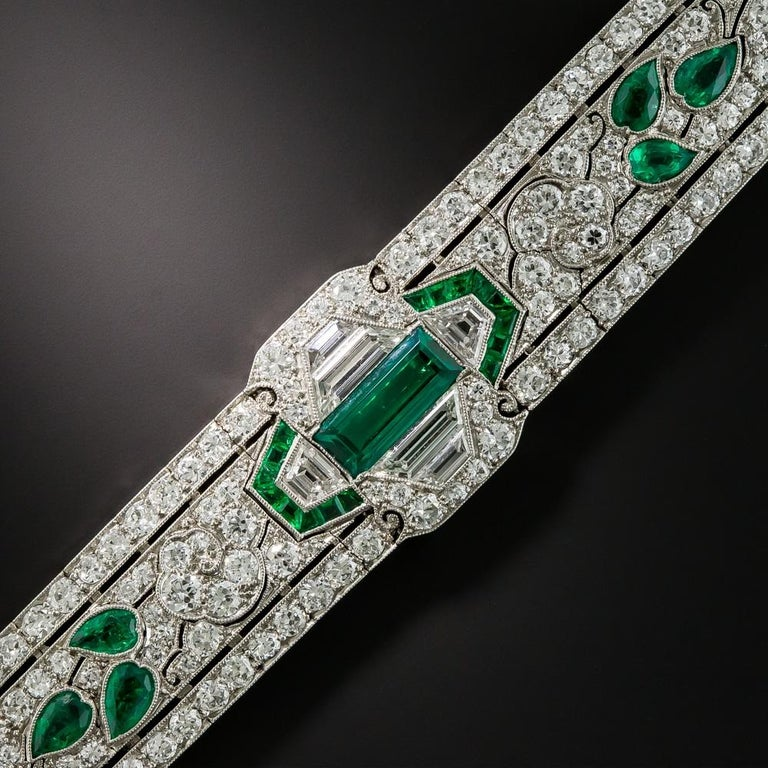 Behold the crème de la crème of Art Deco bracelets! Few, if any, original Art Deco delicacies rival this stunning exemplar of 1920's vintage jewelry quality and virtuosity. Beginning with an absolute gem 1 carat emerald in the center, this wearable