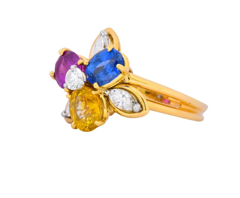 Designed as a flower with sapphire and marquise cut diamond petals, completed by split shank  Total diamond weight is approximately 0.45 carat, F/G color with VS clarity  Sapphires weigh approximately 3.60 carats total and are well-matched in