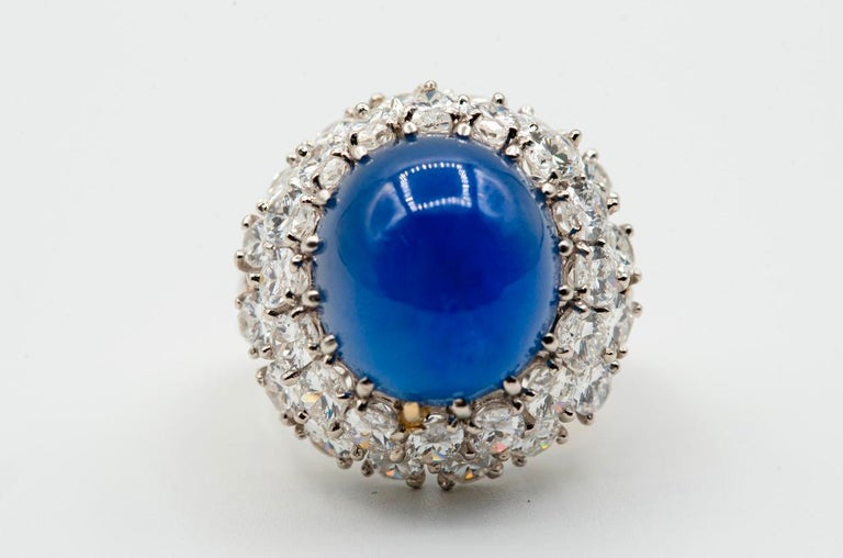Oscar Heyman Cabochon Sapphire & Diamond Cocktail Ring AGL certified 12.74 Ct Cabochon Sapphire  Diamond Weight: approx 6.72 cts Platinum Ring Size: Re-sizable to any size free of charge  Rubbed Makers Mark