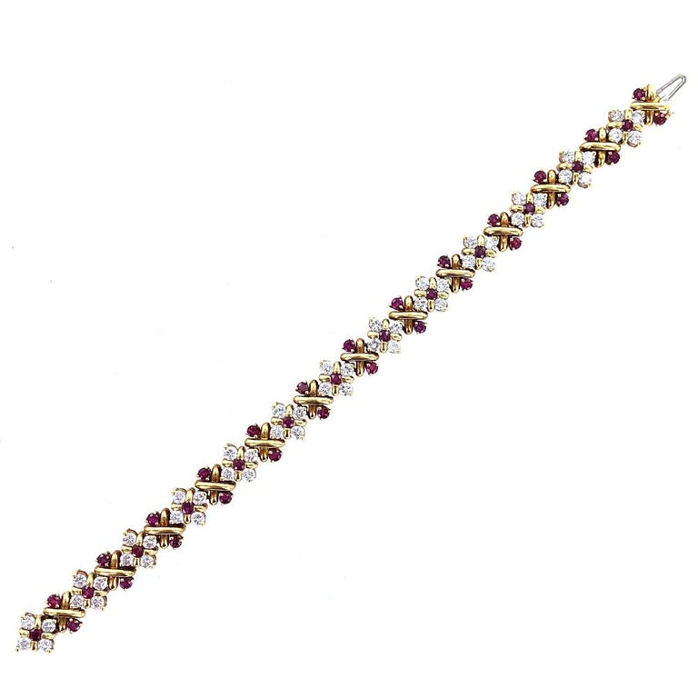 Beautiful diamond and ruby bracelet designed by Oscar Heyman & Brothers for Tiffany & Co. This magnificant estate piece is crafted in 18 karat yellow gold. The 4.16 carat total weight of diamonds are graded F-G color and VS clarity. Another 3.70