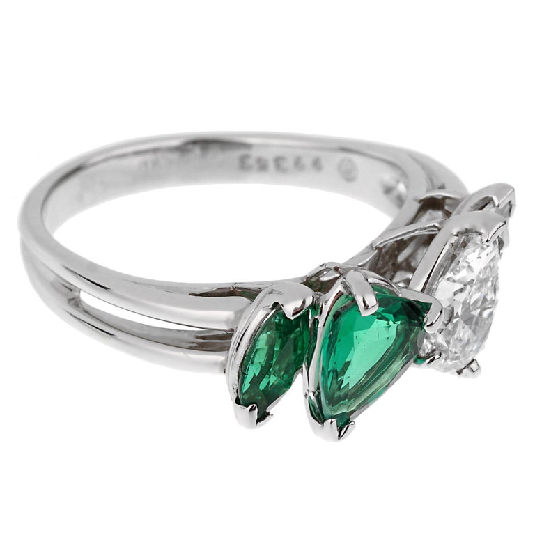 An incredible Oscar Heyman cocktail ring showcasing a 2 rich natural emeralds, the pear shaped GIA graded emerald measures .66ct and a .10ct marquise cut followed by a GIA certified D color VS1 pear shaped diamond, and a ,10ct marquise cut diamonds.