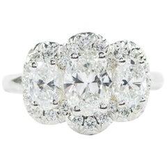Oscar Heyman Platinum 2.22ct Oval Diamond Three-Stone Ring with Pave Halo, GIA
