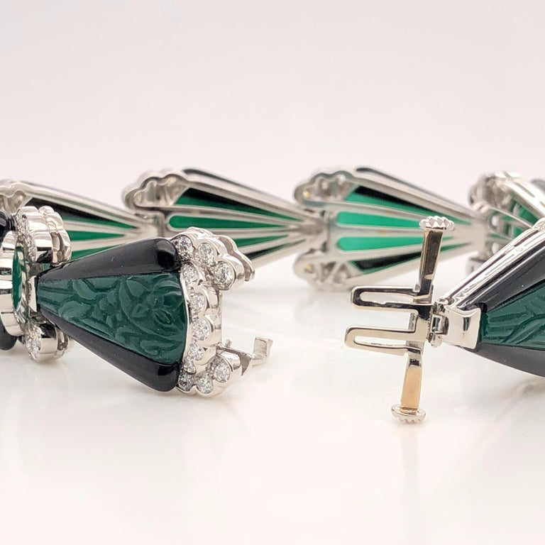 Oscar Heyman platinum bracelet with carved black and green onyx and 88 Round Diamonds weighing 3.07cts. All stones are F-G/VS+ quality. It is stamped with the makers mark, IRID PLAT, and serial number 804130.  The bracelet measures 7'' in length and